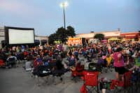 """As the sun sets the screen begins to illuminate and attendants prepare for a screening of """"Dazed and Confused"""" at Alamo Drafthouse in Richardson on July 13, 2013."""