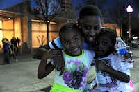 Stopping for a quick bite to eat, Auadia, 5, Christine Benson, and Ajayla, 4, enjoy the pleasant weather at the annual Spring Block Party in the Arts District on a warm Friday evening in Dallas.Alexandra Olivia - Special Contributor
