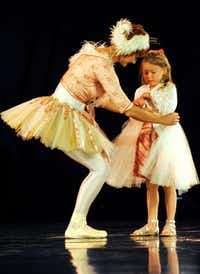 """Before the show, audience member Annika Rogers, 6, of Southlake, spends a moment on stage with a performer on the opening night of Cirque du Soleil's """"Kooza"""" on Wednesday, Sept.  19, 2012 in Dallas."""