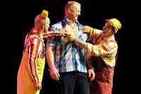 """Clowns brought audience member Rick Cowen of Dallas on stage for some hilarious hijinks on the opening night of Cirque du Soleil's """"Kooza"""" on Wednesday, Sept.  19, 2012 in Dallas."""