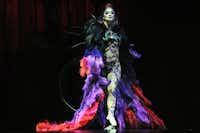 "Hoop manipulation artist Irina Akimova makes a dramatic entrance on the opening night of Cirque du Soleil's ""Kooza"" on Wednesday, Sept.  19, 2012 in Dallas."