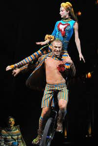 """Unicycle duo Yuri Shavro and Olga Tutynina performed on the opening night of Cirque du Soleil's """"Kooza"""" on Wednesday, Sept. 19, 2012 in Dallas."""