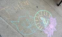Chalk drawings on the sidewalk at Buzz Brews' Deep Ellum location, which was one of four chalk spots for Chalk-tober Fest in Dallas on Sunday, Oct. 21, 2012Alexandra Olivia