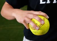 Three fingers across the seams is the way to grip a softball, our coaches say.