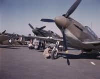 """P-51 (""""Mustang"""") fighter planes being prepared for test flight at the field of the North American Aviation, Inc., plant in Inglewood, Calif. in 1942."""