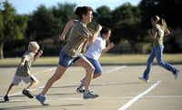 Den leader Christine Allen ran sprints recently with Pack  261 members, who were working on their ScoutStrong fitness badges.