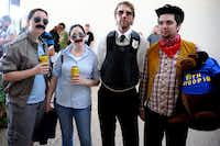 """Friends Crystal Gann, Celi Bowling, Joe Aholt, and Anthony Bowling dressed as characters from """"Hot Fuzz"""" for the first showing of """"The World's End"""" Alamo Drafthouse in Richardson on July 25, 2013."""