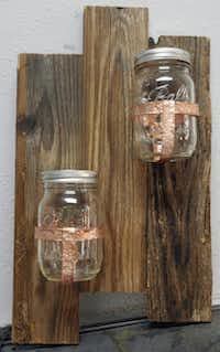 Hand-hammered copper banding affixes Mason jars to reclaimed wood (right) to create a planter.Ron Baselice  -  Staff Photographer