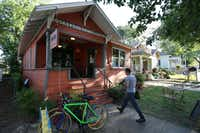 A patron walks up to the entrance of The Wild Detectives, a small independent bookstore and cafe in Oak Cliff.Andy Jacobsohn - Staff Photographer