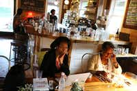 Rosalyn Story (left) and Pamela Ice, both of Dallas, sit near each other while reading at The Wild Detectives.Andy Jacobsohn - Staff Photographer