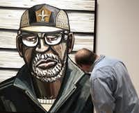 """David Mitchell Dillard of Dallas studies the work of Dallas artist David Bates on Wednesday, February 12, 2014. The title of the painting,  'Katrina Portrait VII (Buddy)"""", 2006.The Modern Art Museum of Fort Worth and the Nasher Sculpture Center, Dallas, present a joint exhibition of his work on view February 9th through May 11, 2014. The exhibition is a retrospective of Bates's work installed in both locations with an emphasis on painting in Fort Worth and sculpture and works on paper in Dallas. This is the first collaboration between the two museums."""