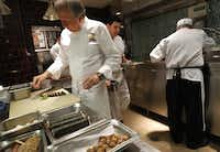 Chef Dean Fearing and his team recently were hard at work preparing for a big night in the restaurant and a large catered event to be held the following day.