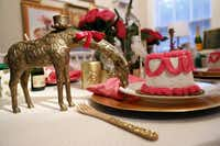 Smrekar searches her house for accessories that work with a party's tone and theme. She added a ribbon to the neck of a brass giraffe and it became part of the tablescape.
