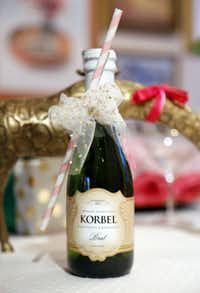 """""""I always start with an idea for a color for a party, rather than a theme,"""" says Melissa Smrekar. For her Pop! Fizz! Clink! celebration, she chose pinks, gold and glitter."""