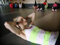 Team USA figure skater Ashley Cain works out by doing crunches during her father/coach Peter Cain's practice at the Dr Pepper Star Center in Euless, Wednesday, January 22, 2014. Cain is a 4-time National medalist who hopes to compete in the 2018 Olympics.