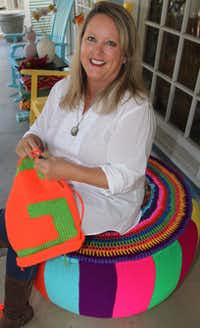 Shabby Sheep owner Ronda Van Dyk is coordinating the new park's yarn bombing.