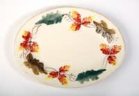 Autumn leaves: Serve dinner guests from a hand-painted platter, $49.95, and bowl, $39.95, part of the Tuscan Leaves collection from Sur la Table, Dallas and Plano, and online at surlatable.com.