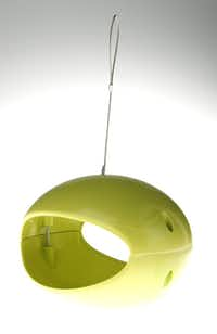 An acid-green, biodegradable bamboo bird feeder pleases the modernist's eye. $30 at Wild Birds Unlimited, Dallas (East Mockingbird location). More colors available.