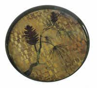 An 18-inch tray with a pine motif is contructed from a poly-ceramic composite that looks and feels like hand-painted lacquer. $39.99 at Nicholson-Hardie Garden Shop, Dallas.