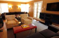 The long living room in a Dilbeck-designed house in Stevens Park had a sectional at one end and a television at the other. The designer divided the room into two seating areas with the television moved to a side wall.