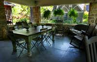The large side porch, originally a porte-cochere, is the family's favorite location to dine and lounge.
