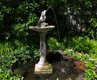 Longtime owner Lynn Houston recounted the property's past to Whalen, including children catching tadpoles in the small pond at the fountain's base.