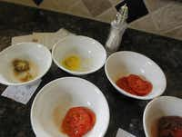 Nevil organizes a taste test for just-picked tomatoes.Mona Reeder  -  Staff Photographer