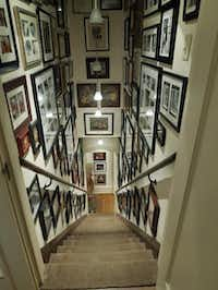 Only the photographs and light fixtures have changed over the years in the back staircase.Ron Baselice