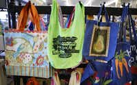 Locally sourced products, like these bags, are part of the invenrory at Gecko Hardware in Northlake Shopping Cente.