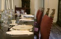 The arboretum required a new, larger top for the antique dining table. Goodchild also reproduced existing dining chairs.
