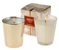 Enjoy the festive aroma of the holidays with soy-blend candles from Nest in 8.1-ounce sparkling gold or gold/white containers. Choose from woodsy Birchwood Pine or pomegranate-orange Holiday Classic. $39.50 each. At La Foofaraw and Culinary Connection, Plano