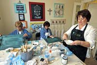 Pam Miller (left) of San Angelo and Mary Shurtleff (center) of Lampasas finish up their project at a class taught by Donna Haile (right) at her home in Savannah.