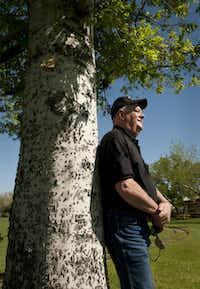 Frank Rush III, the third generation of his family in the amusement park business, rests against one of the many trees the Rushes have nurtured.