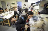 Valerie Martinez uses a small torch on a project in her jewelry-making class.Robert W. Hart  -  Special Contributor