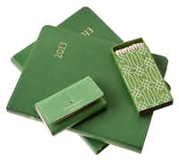If it's the year of emerald, what's more appropriate than a calendar in the anointed hue? The Graphic Image 2013 calendar is $95 at Nest in Dallas. Kate Spade's key wallet in green is $39.99 at T.J. Maxx, multiple locations. Mecox Gardens in Dallas offers an elegant matchbox, $5.