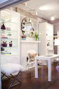 By keeping the furniture pieces white, it's easy to change up the look and feel of the feminine space, Dallas designer Abbe Fennimore says. With a new wall color and swapping out the purple accessories, the room can take on a whole new look.