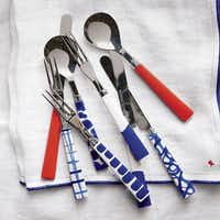 Festive flatware: Every day's a holiday with bright flatware. $15.95 for sets of six forks, spoons and knives at Crate & Barrel.Crate and Barrel - Crate & Barrel