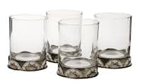 Double old-fashioned glasses are accented with a cast-pewter base. $189 for four at Anteks Home Furnishings, Dallas.