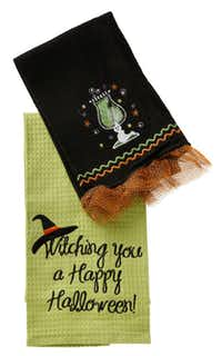 The cocktail towel (top) is $10 at Culinary Connection, Plano. The green, waffle-weave hand towel is $12.50 at Paper Affair, Dallas, Frisco and Plano.