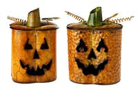 Pumpkin Jack luminaries of tin hold votives. $24 each at Showcase Home Decor, Dallas.