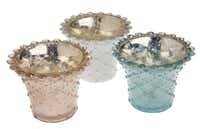 Frosted, pastel tea light holders of beaded glass emit a delicate glow. $6.95 at Sample House & Candle Shop, multiple locations.