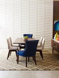 Jonathan Adler Bleecker dining table, $1,675; Bleecker arm chair, $530; and Bleecker side chairs, $345 each.