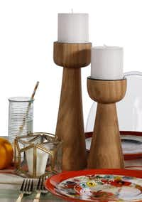 Crate & Barrel's Owen pillar holders are made of acacia wood. $22.95 and $26.95.Evans Caglage  -  Staff Photographer