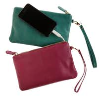 For the woman who just can't live without her cell phone, the pebble leather Mighty Purse is the essential accessory. A center pocket hides a USB charging cable and built in battery capable of recharging most Smartphones and tablets. An LED indicator shows battery and charging status. Multiple colors available. $99.95 at La Foofaraw, Plano