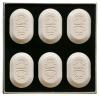 Handcrafted of natural ingredients, artisan soaps will pamper her the way she deserves. Personalization with a name, logo or initials makes the gift even more special. A 6-bar set of 4.5-ounce oval soaps in a gift box is $52 at Linen Boutique, Dallas
