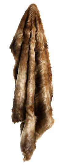 A luxe, animal-friendly throw replicates the warmth and luxury of real fur. Perfect for curling up on a cold winter night, it is generously sized and constructed of seamless, densely woven fur of acrylic and polyester. Multiple colors available. $165 to $229 at Kathy Adams Interiors, Plano