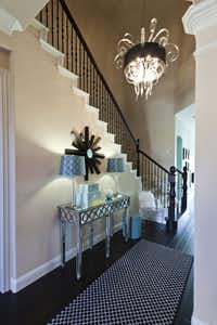 The jellyfish-style glass chandelier in the entry announces the bold design of the Mohammad home.