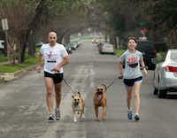 Michael Friedhoff and Angela Turnage run with their SPCA rescues, Nevada (left) and Shasta.