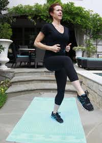 Kristin Moses of BodyBar fitness studio shows off high knee raises, part of a 20-minute workout.