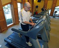 Larry Blend, 71, of Fairview works out on the tread mill at the gym in the clubhouse of his community, Heritage Ranch.